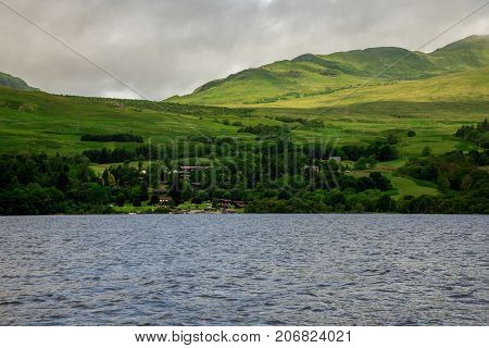 A View To Loch Tay Highland Lodges Village Taken From The Rental Boat In A Lake