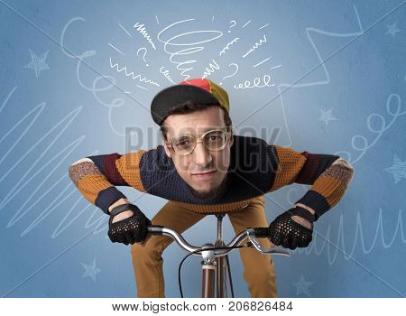 Young foolish crazy rider with doodle on the background