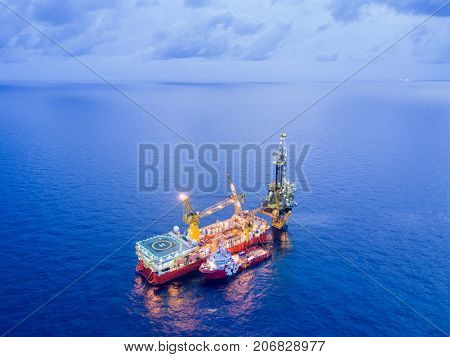 Aerial View of Tender Drilling Oil Rig (Barge Oil Rig) in The Middle of The Ocean at Sunrise Time