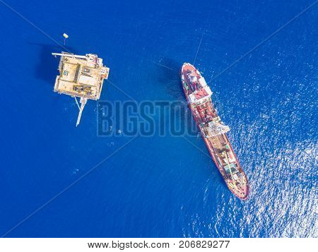 Soil Boring Boat (a geotechnical drilling cum analogue survey vessel) close to a oil platform