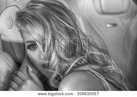 Sensual Blonde Girl In Luxury Car.