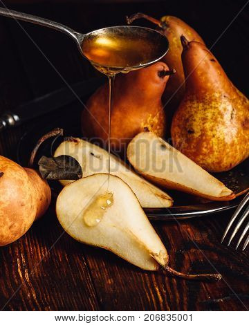 Golden Pears with Sliced One and Spoonful of Honey.