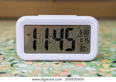 Digital Alarm Clock on the floor and numeric.