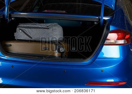 Close-up of car trunk with bags. Modern sedan car trunk