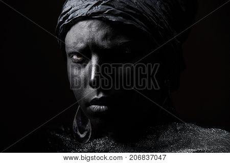 Female African voodoo shaman. Horizontal close-up photo