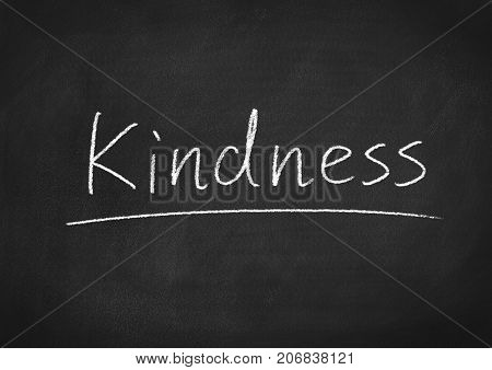 kindness concept word on a blackboard background