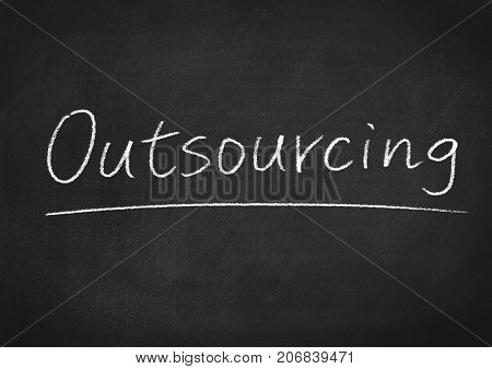 outsourcing concept word on a blackboard background