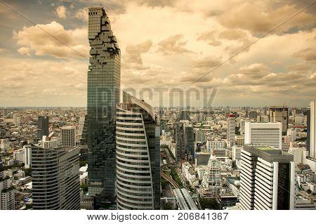 Top view of cityscape Bangkok modern office buildings, condominium in Bangkok city downtown with sunset sky , Bangkok , Thailand