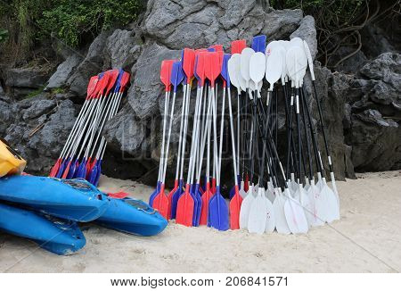 Paddle for kayaking leaning against the rocks near the beach.Ang Thong archipelago island.Thailand.