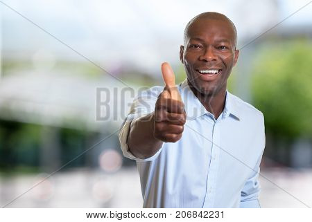 African american businessman showing thumb up outdoor in summer