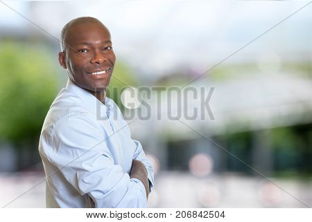 African american businessman with crossed arms outdoor in summer