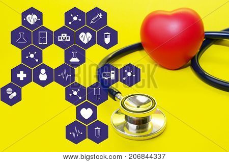 stethoscope and red heart on yellow background with medical icon in hexagon pattern heart health care laboratory science chemical and medical research concept