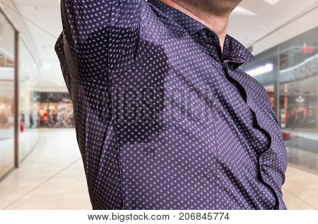 Man With Sweating Under Armpit In Shopping Center