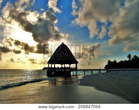 beautifull sinset beach at the maldives resort