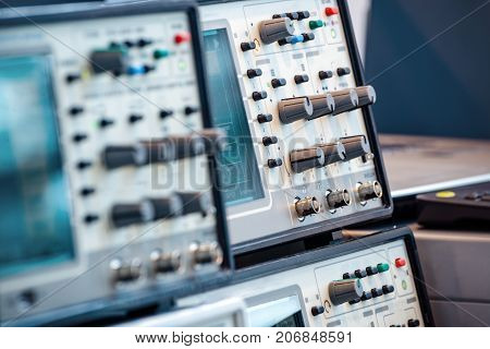Modern digital measuring instruments. High-frequency equipment. Abstract industrial background.