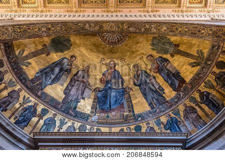 Rome, Italy - August 21, 2016: Interior view of Papal Basilica of St. Paul outside the Walls. Detail of fresco paintings on apse. It is one of Rome's four major basilicas.