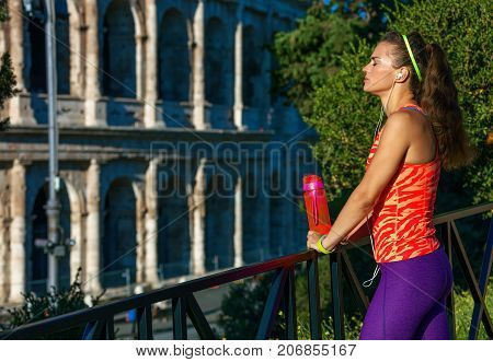 Woman Jogger With Water Bottle Relaxing After Workout