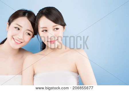 two beauty woman look somewhere with healthy skin care on the blue background