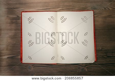 Old retro open photo album book with copy space for image or text on burnt table surface background.