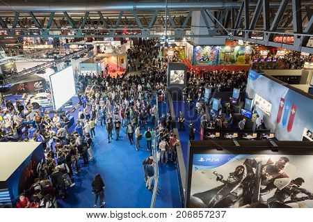 MILAN ITALY - SEPTEMBER 29: Top view of people and booths at Games Week 2017 event dedicated to video games and electronic entertainment on SEPTEMBER 29 2017 in Milan.