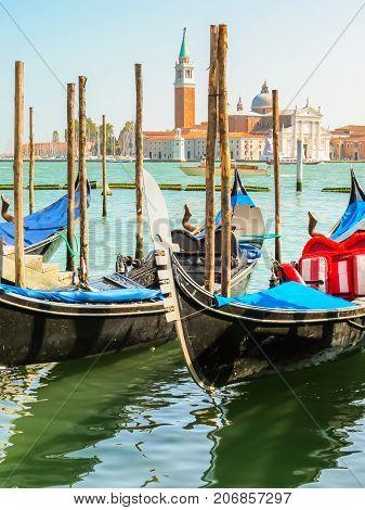 VENICE, ITALY - SEPTEMBER 3, 2013: Gondolas moored in the Venetian lagoon. Venice, Italy