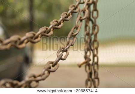 The old chain on a blurred background in warm tones