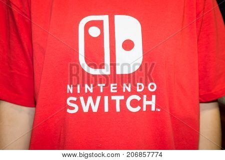 MILAN ITALY - SEPTEMBER 29: Detail of Nintendo Switch t-shirt at Games Week 2017 event dedicated to video games and electronic entertainment on SEPTEMBER 29 2017 in Milan.