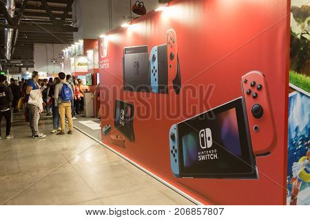 MILAN ITALY - SEPTEMBER 29: People visit Games Week 2017 event dedicated to video games and electronic entertainment on SEPTEMBER 29 2017 in Milan.