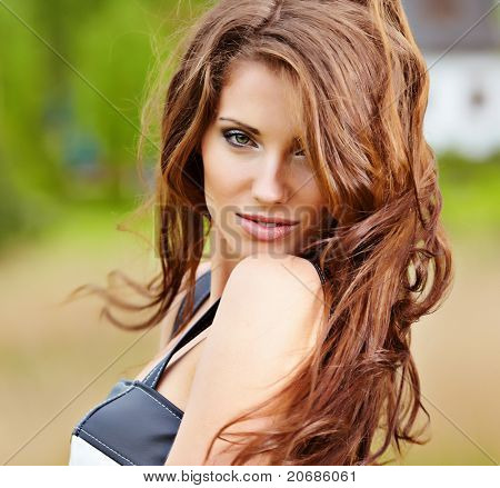 portrait of cute red haired young woman, outdoor