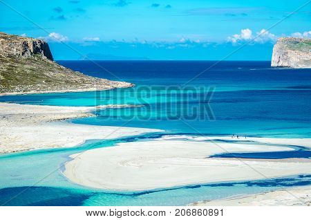 Amazing view of Balos Lagoon with magical turquoise waters, lagoons, tropical beaches of pure white sand and Gramvousa island on Crete, Greece