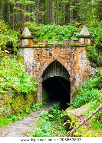 Upper entrance to tunnel of historical Schwarzenberg shipping canal, Sumava Mountains, Czech Republic.