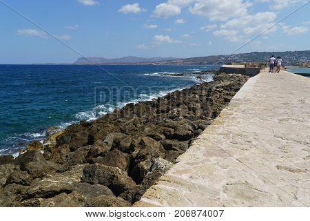chania greece wall and coast with blue sky