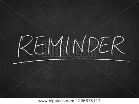 reminder concept word on a blackboard background