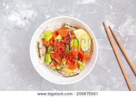 Hawaiian fish poke bowl with rice and avocado.