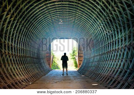 Silhouette Of A Man In The End Of Tunnel