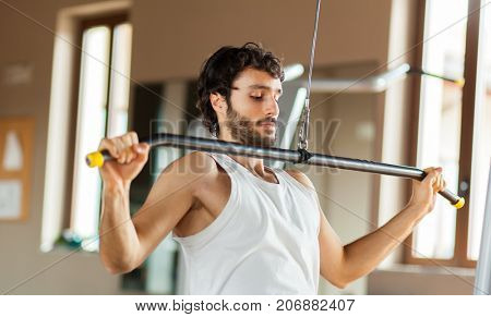 Man lifting weight at the gym