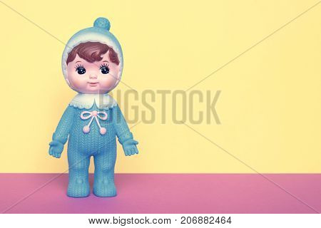 Cute vintage Japanese blue plastic doll on pastels color background with room for copy.