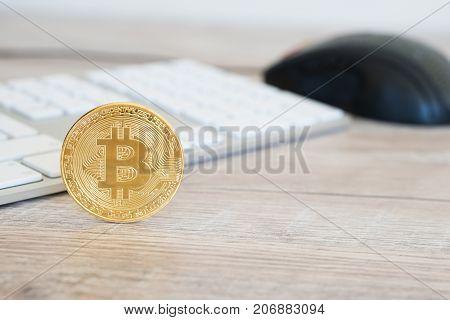 Golden Bitcoin On A Wooden Desk