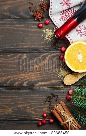 Mulled wine ingredients on a dark wooden background, top view, copy space.