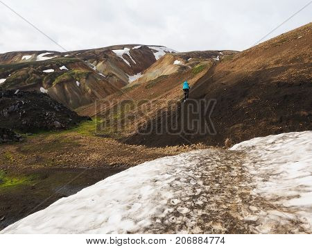 A mountain path trail through the snow and colored mountains in the Landmannalaugar valley Iceland