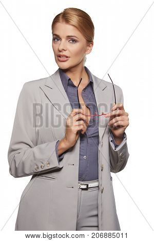 beautiful young businesswoman portrait, isolated over white background
