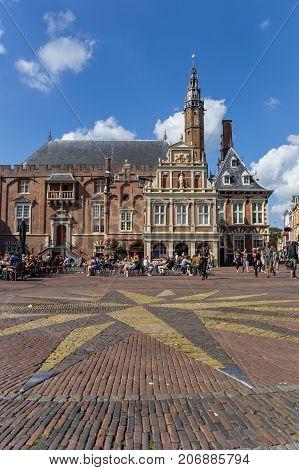 HAARLEM, NETHERLANDS - SEPTEMBER 03, 2017: Mosaic star in front of the town hall of Haarlem Netherlands