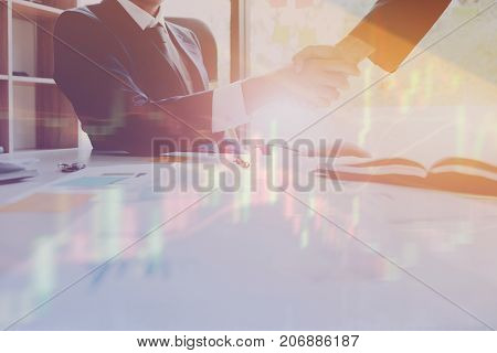 Double Exposure Of Business People Handshake And Stock Chart, Investment Concept.
