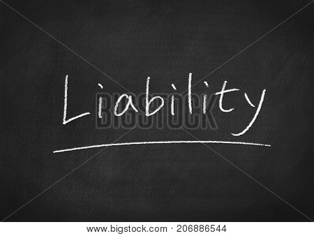 liability concept word on a blackboard background