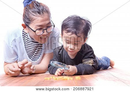 asian family mother and children playing on wood floor