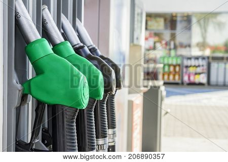 Gasoline and diesel distributor at the gas station. Gas pump nozzles.