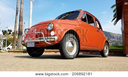 Menton France - September 9 2017: Old Red Fiat 500 L Parked on the Esplanade Francis Palmero in the City of Menton on the French Riviera