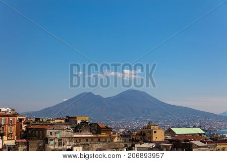Panorama of napoli with vesuviuscloidds and buildings