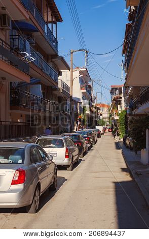 Stavros Greece - September 04 2017: One ordinary street during day apartments and houses for rent.
