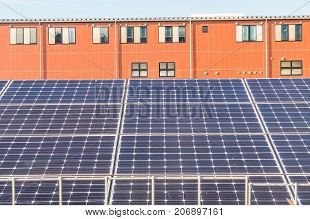 Solar power panels Photovoltaic modules for innovation green energy for life with blue sky background.